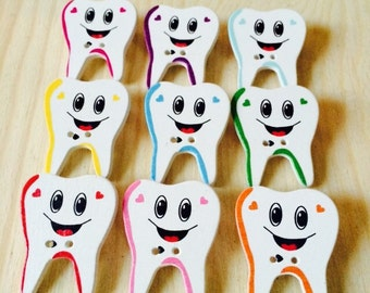 Set of 4 adorable tooth pins multi colored