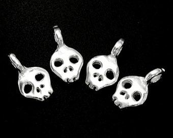 6 of 925 Sterling Silver Skull Charms 5x6mm. :th1537