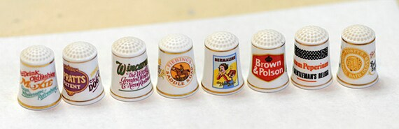 Lot of 8 Vintage ENGLISH Porcelain ADVERTISING THIMBLES.. Very Cute Graphics