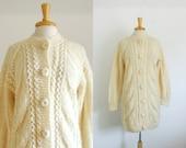 1970s mini sweater dress/ oversized cardigan in  off white size medium or large