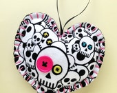 Hand Stitched Skull Fabric Heart Ornament. Dark pink and chartreuse (green-yellow) buttons. Pink embroidery floss stitching. Ready to hang.