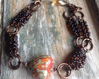 Lampwork heart, farfalle beads and copper bracelet