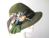 Authentic vintage 60s green olive wool Dolomintenhut men's hat with a large feather pin. Made in Austria. Size 6 7/8