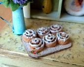 1/12 scale miniature dollhouse cinnamon rolls on the board.