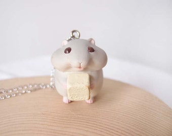 Miniature cute hamster eat cheese necklace