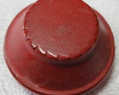 "Vintage red wooden button, tower Martello tower shape, 1"" in wide at base, sloped sides to cog cut flat top. Sew through tunnel. UNK13.1-9,3"