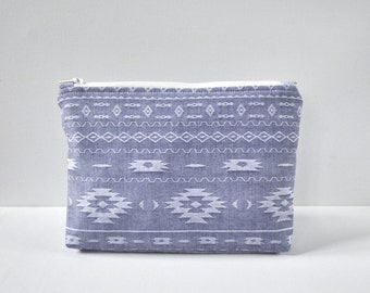 Woman's stonewash light blue denim Native American stitch detail padded cosmetics travel make up pouch light blue and white print in large.