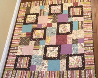 Handmade lap quilt double sided using Alexander Henry fabric collection