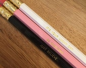 Personalized pencil. Available in black/white/pink.