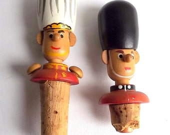 Two wooden bottle stoppers, soldiers, guardsmen with bearskin hats