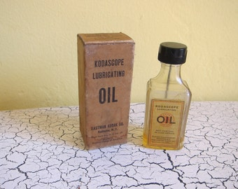 Antique Eastman Kodak Kodascope Lubicating Oil bottle and original box.