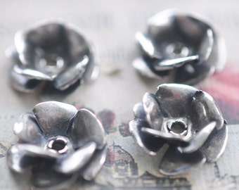Four teenie, riveted brass roses, Sterling Silver Finish