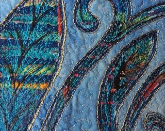 Textile art: blue leaf machine embroidery