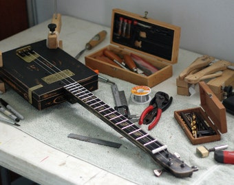 Learn to make Homemade cigar box Blues slide guitars DVD video covering both 3 & 4 string handmade instructions for great tone