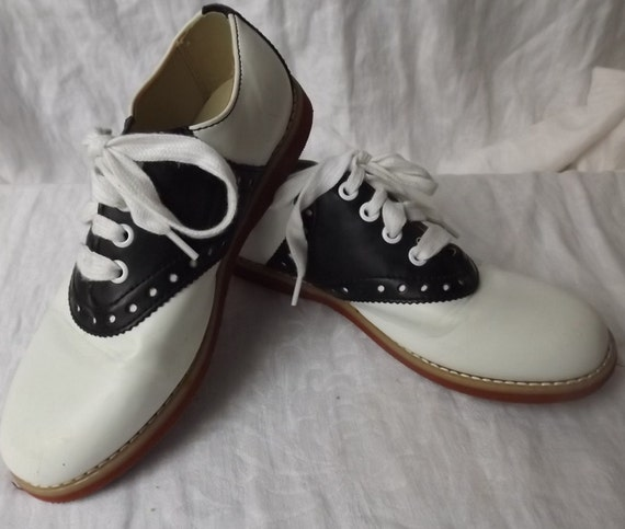 black and white saddle shoes size 4 shoes by ernaandco