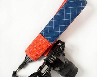 DSLR camera strap cover with lens cap pocket.  blue and orange.