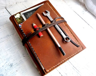 Large leather travel journal with inside and outside pockets- the ultimate travel journal