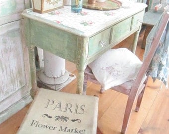 A Vintage French french flower shop seat with prairie scene shabby chic