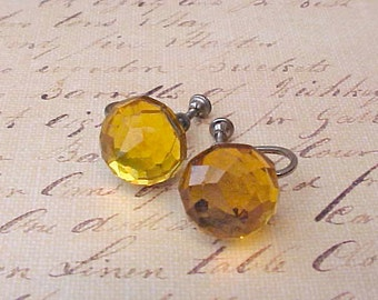 Elegant Vintage Earrings of Luminous Faceted Amber Colored Glass