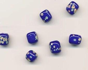Seven Japanese transparent cobalt blue millefiori short cylindrical lampwork glass beads - 10 x 9 mm