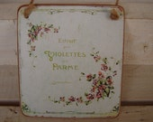 small,vintage,extrait violettes de parme,advertising image,sealed onto wood with string hanger