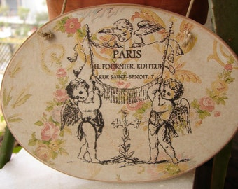 French,wooden, oval sign, vintage roses swags & cherubs with Paris address, image sealed onto wood, string to hang