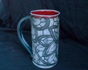Blue, lace imprinted beer mug