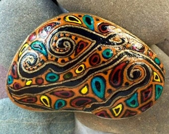 Paisley River / painted stone / orange / Aztec / fiesta / Sandi Pike Foundas / from the sea / Cape Cod
