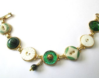 GREEN Antique button bracelet. Mother of pearl,china and glass buttons, gold links. One of a kind