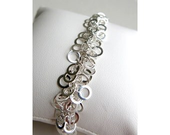 Meshed link sterling silver bracelet  with flat soldered rings and lobster clasp closure
