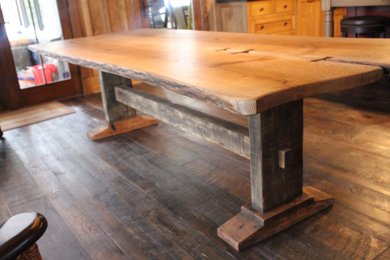 live edge oak harvest table with trestle base and mortise and