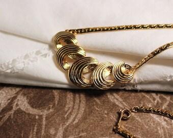 Ribbon Curl Gold tone necklace 1989 Vintage Avon