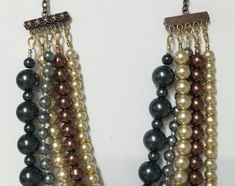 Multi-strand, multi-colored pearl necklace.