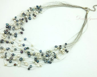 Grey and white freshwater pearl on silk necklace.