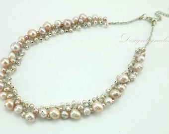 Light pink freshwater pearl,silver plated beads on sik necklace.