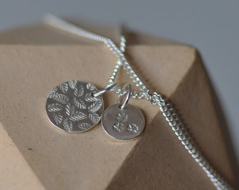2 sterling silver small stamped circle charms on a curb chain Delicate pretty floral pendant 16 inch or 18 inch layer necklace
