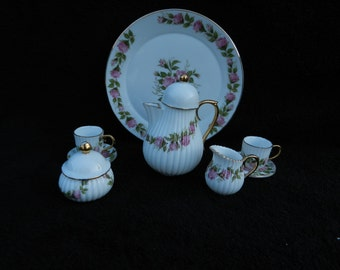Child's Toy Tea Pot and Service Set: Porcelain Hand Decorated.