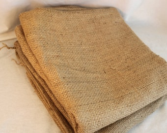 Two, jute coffee bean bags. Two authentic coffee bean bags. Coffee bean bag fabric.