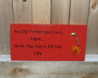 An Old Fisherman Lives Here....With The Catch Of His Life Hand Painted Relcaimed Wood Sign Fishing Lure Adorned