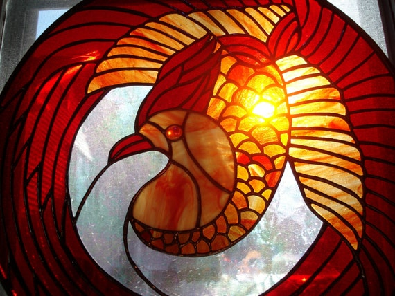 Stained glass Phoenix Bird Greek Mythology of long-lived, reborn, renew, regenerated, excellence and beauty. reds/orange and clear