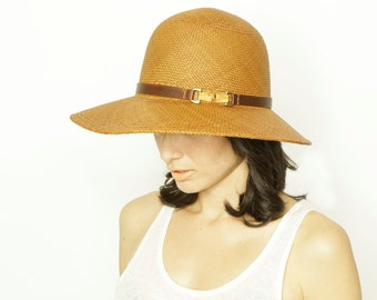Introducing Penelope: Tumeric panama straw made in Ecuador and hand blocked in Brooklyn.  Hand dyed leather trim and bamboo finding.