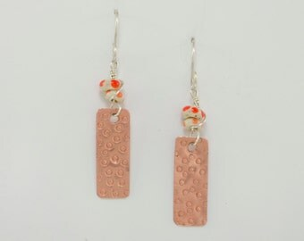 The Pacifik Image's Goodwin and Maxwell: Orange Dotted Lampwork Recycled Glass Earrings with Original  Handstamped Copper Dangles