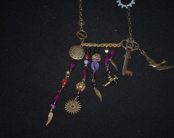 Gearing up to fly purple and brass slightly readjustable necklace.