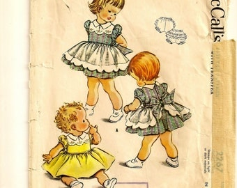 "A 1950's Full Skirt, Short Puff Sleeve Dress with Integrated Apron and Bloomer Panties Pattern: Toddler's Size 2, Breast 21"" • McCall's 2267"
