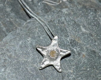 Fine silver textured star pendant with smoky crystal on a 16'' sterling silver chain