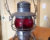 Vintage Adlake Kero railroad lantern with ruby red glass globe