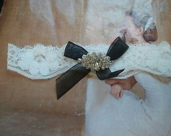 Wedding Toss Garter - Black Bow with Crystal Gem on a White Lace - Style TG120