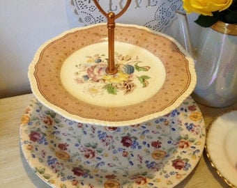 2 Tier Wedding Cake Stand made with mismatched vintage chintz and floral plates.