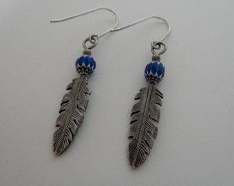 Silver feather earrings with blue beads