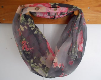 "Infinity Scarf. Charcoal with pink flowers.  Approx 5"" x 72"".  Great light weight scarf to add  to your outfit."